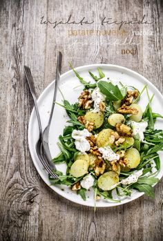 warm salad with rucola, potatoes, stracciatella di bufala and walnuts