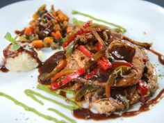 """Camagueyana-Style Pork Loin — El Figaro : Named for the Camaguey province, this pork loin is made with sauteed peppers and onions in a light sauce. Guy called this simple dish absolutely """"dynamite."""""""