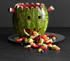 Let this melon monster make a scene at your Halloween bash. To create it, cut open one end of a watermelon and scoop out the flesh with a large spoon or melon baller. Trim a zigzag edge along the top, and cut eyes and a mouth. Add horns by securing leftover melon pieces with toothpicks. Fill the head with bite-size fruit—we used melon cubes, sliced strawberries, blueberries, and grapes—and add more pieces spilling out of the mouth.