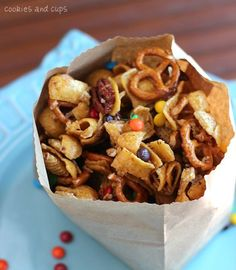 Frito Snack Mix  One 10.5-ounce bag of Fritos   2 cups Rice Chex Cereal   2 cups Pretzel Twists   1 1/2 cups nuts (used walnuts, but peanuts, cashews or mixed nuts would work great)   1 cup light brown sugar, packed   1/2 cup butter   1/2 cup light corn syrup   1 cup of mini M