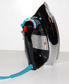 G.E. steam iron. 1960's  Just like my mothers!  And boy do I remember having the chore of ironing with this every week for our family of eleven!!!