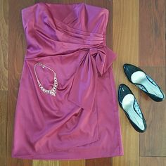 """WHBM Cranberry Semi-Formal Dress This gorgeous wrap around bow front dress is a merlot/cranberry color. It was only worn once, but the possibilities for it are endless. It works for any occassion: weddings, formal/semi-formal events, school dances. No matter where you wear it, you're bound to get compliments! Comes with garment bag. Smoke-free home and stored in garment bag away from pets!  HOST PICK 3/21/15 """"Girly Girl"""" Party White House Black Market Dresses Strapless"""