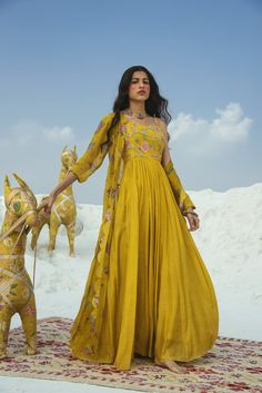 This set features a cotton silk mustard maxi with a hand-embroidered yoke. It is paired with a floral cheet print scalloped jacket in organza. Color: Mustard Yellow Fabric: Cotton Silk; Organza Care: Dry Clean Only Pakistani Designer Clothes, Pakistani Dresses, Indian Dresses, Indian Outfits, Western Gown, Western Dresses, Western Outfits, Yellow Maxi, Yellow Fabric