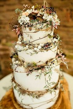 rustic-wedding-cakes-photos-with-greenary-white-berry-and-wild-flower