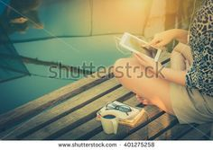 stock-photo-young-woman-sitting-on-wood-bridge-touching-on-small-tablet-pc-screen-while-listening-to-music-in-401275258.jpg (450×319)