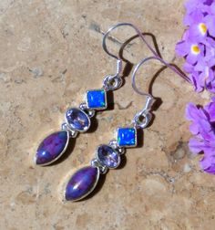 These are beautiful and delicate pair of blue fire opal, amethyst and Russian Charoite earrings set in sterling silver.