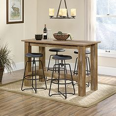 Entertain and bring people together with the Boone Mountain counter-height dinette table in Craftsman Oak finish. Patio Bar Set, Pub Table Sets, Bar Tables, Dining Sets, Counter Height Dining Table, Wood Counter, Bar Dining Table, Table Stools, Bar Height Table