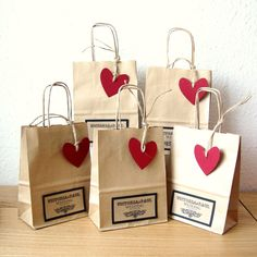 Elegant small brown paper bag for your wedding favours. Each bag comes with a lovely Red Heart tag hung with natural string. A combination of rustic, elegant and eco-friendly. The bag is also available in White paper with Black or Red Heart tag There are 3 sizes of these personalised bags: Small :15cm x 19.5cm x 8cm gusset £1.80 each Medium : 18cm x 25cm x 8cm gusset £2.00 each Large (A4 size) : 22.5cm x 31.5cm x 10cm gusset £2.20 each
