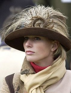 warm brown winter hat w/ medium brim & w/ multiple feather trim