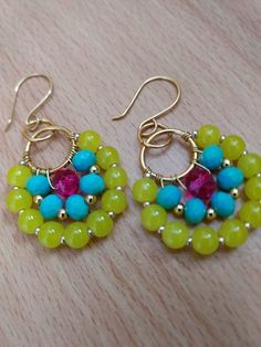 Beautiful handmade fan wire wrapped Earrings made using artistic wire to put together pink, blue and yellow synthetic pearls adorned with golden spacer beads. The wire is tarnish resistant so it will remain bright and shiny for a long time. Several other colors 5 cm long approximately. Ear #wirejewelry
