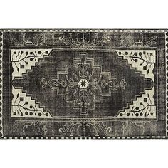 "Anice Rug in 20% off Rugs | Crate and Barrel -- ""The inherent drama of a classic Persian rug stops the show in streamlined black-and-white interpretation of traditional design motifs. Mesmerizing shades of black enliven the surface created by expert shearing and a dense pile for a dynamic look that plays both antique and contemporary. Handknotted of a blend of New Zealand wool with approximately 28 knots per square inch—6 more per square inch than the customary 22."""