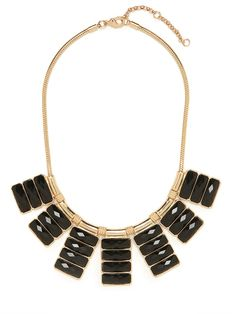 Onyx is known to guard against negativity and was considered a symbol of success in Ancient India. So can you blame us for falling for this necklace, which features cool pendants crafted from that very stone?