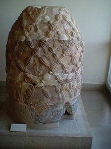 The Omphalos stone, or Navel of the World. Resembles an ancient terracotta, bee-covered skep from Delphi, Greece, home of the Delphic Oracle. Bee Skep, Bee Hives, Objets Antiques, Art Et Architecture, I Love Bees, Greek Culture, Bee Art, Save The Bees, Bee Happy