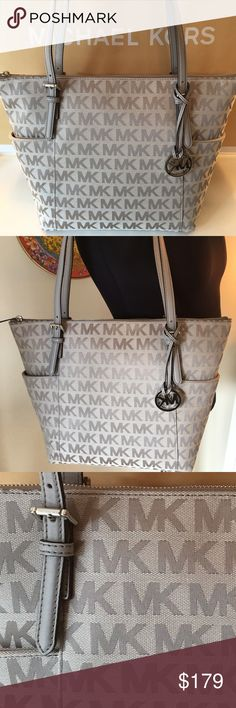 MICHAEL KORS NEW LARGE TOTE 100% AUTHENTIC MICHAEL KORS NEW NEVER USED WITH TAGS LARGE TOTE 100% AUTHENTIC. STUNNING AND ALWAYS FASHIONABLE TOTE. PERFECT FOR ANY OCCASION. VERY ROOMY BAG THAT CAN FIT ALL OF YOUR ITEMS. IT HAS METAL FEET TO KEEP THE BOTTOM OF YOUR BAG CLEAN. THIS BAG MEASURES 16 INCHES WIDE BY 12 INCHES TALL . THE SHOULDER STRAPS HAVE A 10 INCH DROP Michael Kors Bags Totes