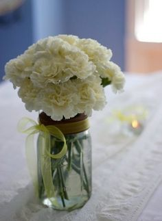 This with red carnations and the red + white ribbon I have would be super cute for the centerpieces.