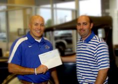 Lindale ISD earned 4,880 dollars during their Drive 4UR School event this past September. General Manager Ryan Hopson is happy to present the check to Head Football Coach Mike Meador.