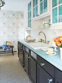 Love the subway tile with black cabinets and have you ever seen a blue counter top? Love this. (Robin's client?)