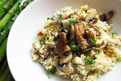 "Vegan/Paleo Mushroom ""Risotto"" (made with cauliflower instead of rice). ETA: This is INCREDIBLY good. I used almond meal instead of ground pine nuts (because no way am I dumping nuts that cost 30/lb in a casserole), coconut oil instead of vegan margarine, and added a handful of chopped sage leaves. YUM."