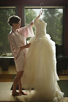A picture with your wedding dress. A must have!