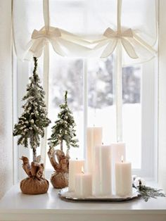 Candles & Evergreens for Nox (For Nox at night the windows are covered or partially covered and a sheet of red glass is added in front of the window to light the outside in red instead of other bright lights that would break night vision and cause light pollution that removes the ability to stargaze.)
