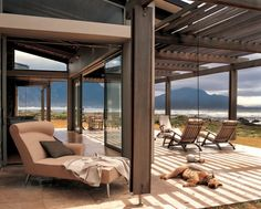 Stefan Antoni Olmesdahl Truen Architects together with interior designers Antoni Associates, have designed the Sprecher House in Hangklip, South Africa.