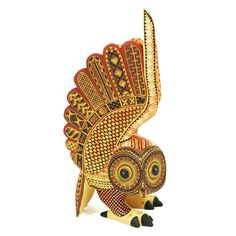 This gorgeous sunshine owl was created by Oaxacan artist Angel Fabian. This <strong>buho</strong> is beautifully painted and carved. The painting is very precise, clean and harmonious.