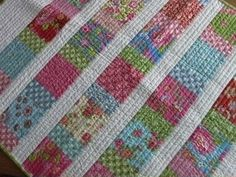 Pretty charm squares baby quilt with dense straight line quilting - inspiration :)  Sweet!