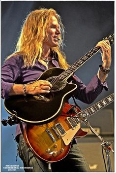 Adrian Vandenberg - Dutch guitarist who led his own band before joining Whitesnake in 1987 for their most popular, eponymous titled LP.