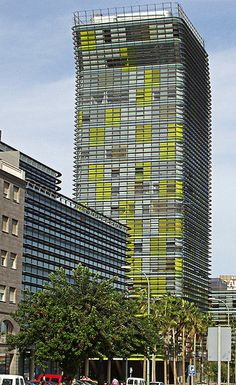 Woermann Tower is a mixed-use tower in Las Palmas on Gran Canaria, Canary Islands, Spain. Completed in 2005, the tower was designed by Abalos & Herreros.  The facade is protected from the sun by solar fins running horizontally around the building, with vegetable motifs etched into the glass. Yellow colour inserts were placed in the windows in strategic locations on the facade.  by Walter Gulielminetti