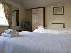 Twin beds in lounge