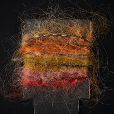 Yarn sample, orange, brown-green, red and pink space-dyed mohair