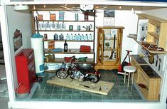 image found on miniatures.com - customer creations this diorama is described as: Harley Garage by Sharon M. of Prince George, VA.