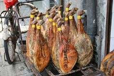 Pork shaks sold in the streets of Guangzhou, China.  These pork shaks look like tennis rackets to me...:D