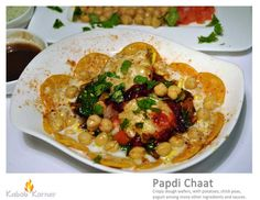 PAPDI CHAAT   . Crispy dough wafers, with potatoes, chick peas, yogurt among many others ingredients and sauces.