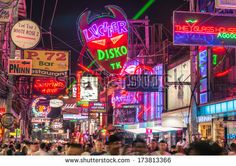 PATTAYA, THAILAND - JANUARY 19, 2014: multicolored neon signs in the heart of the Walking Street of Pattaya. The street is closed to the traffic after 6pm and stays crowded until late in the night.