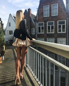 Blonde in mini skirt on bridge