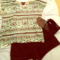 Teal&Black aztec top Fun Aztec dolman top from forever 21! Lightweight! Size small but would definitely fit a medium and bigger bust area! 100% polyester Forever 21 Tops