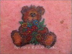 teddy bear tattoo with flowers