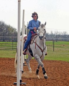 Trotting through a pole pattern helps your horse pick up his shoulders and move over. It gives him something different to think about while he learns flexibility. Journal photo.