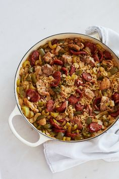 Tender chicken thighs and garlicky Andouille sausage join white rice and the holy trinity of onion, celery, and bell pepper in this scrumptious skillet dinner.