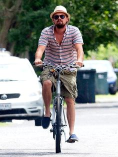 HAIR HE COMES    Ride on! A shaggy Leonardo DiCaprio hops on his bike for a leisurely tour of New Orleans on Monday.