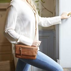 Elektronista Mini Digital Leather Clutch Bag in Caramel | KNOMO | The Elektronista Mini is a stylish and luxurious mini clutch designed for a large smartphone and evening essentials. Comes with a detachable webbing strap, allowing you to carry over the shoulder or cross-body
