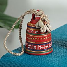 A Beautiful Red Painted Bell beautiful painted terracota bell with sea shells and a hand woven jute string to make a great hanging in your living room. Pottery Painting Designs, Pottery Designs, Paint Designs, Pottery Art, Blue Pottery, Bottle Painting, Bottle Art, Bottle Crafts, Painted Flower Pots