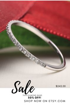 $242 This thin stakable half eternity pave diamond ring features 23 real white diamonds set on a 14K white gold band