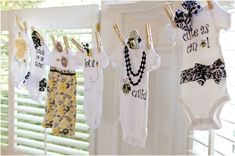 bee themed-decorated onesies. Get bee print, black and yellow fabric and lots of accessories for design your own onesie baby shower activity.