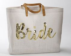 This perfect Bride Jute Tote, is a great gift for the bride. Made with jute, this Jute Tote bag is adorned with phrase Brides in gold with a tasseled zipper pull, and laminated interior. Sized to fit most tablets.