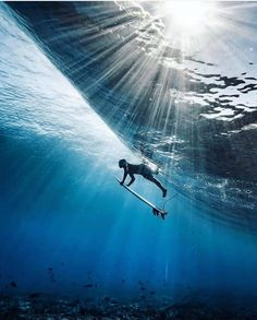 And just like that, French-born, Tahitian-living photographer presents the surf photo of the year. Ripe and mesmerising.