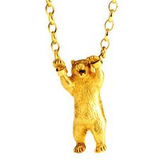 Hand-Cuffed Bear Necklace Gold by Momocreatura £325. Macabre but still oddly attractive.