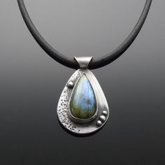 'Dance and Be Merry' Labradorite and Sterling Silver Pendant Labradorite helps to unleash the power of the imagination and to release limitations.