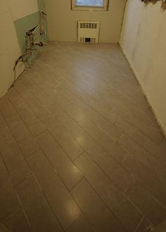 6x24 tile laid on the diagonal. Gorgeous.